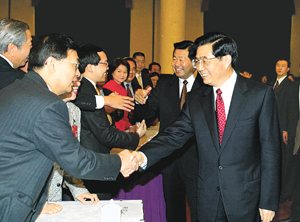 2003-3-7 Hu pointed out that efforts to maintain the prosperity and stability of Hong Kong and Macau
